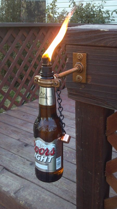 Make unique decorative tiki torches out of glass wine beer for Diy beer bottle tiki torches