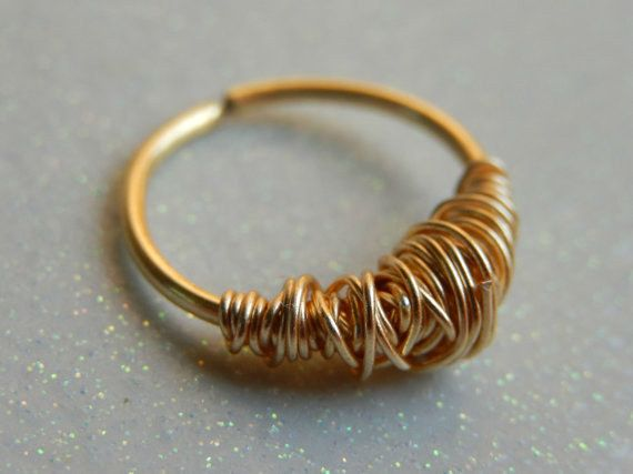 This wire-wrapped vortex. | 21 Unconventional Septum Rings That You Need Immediately