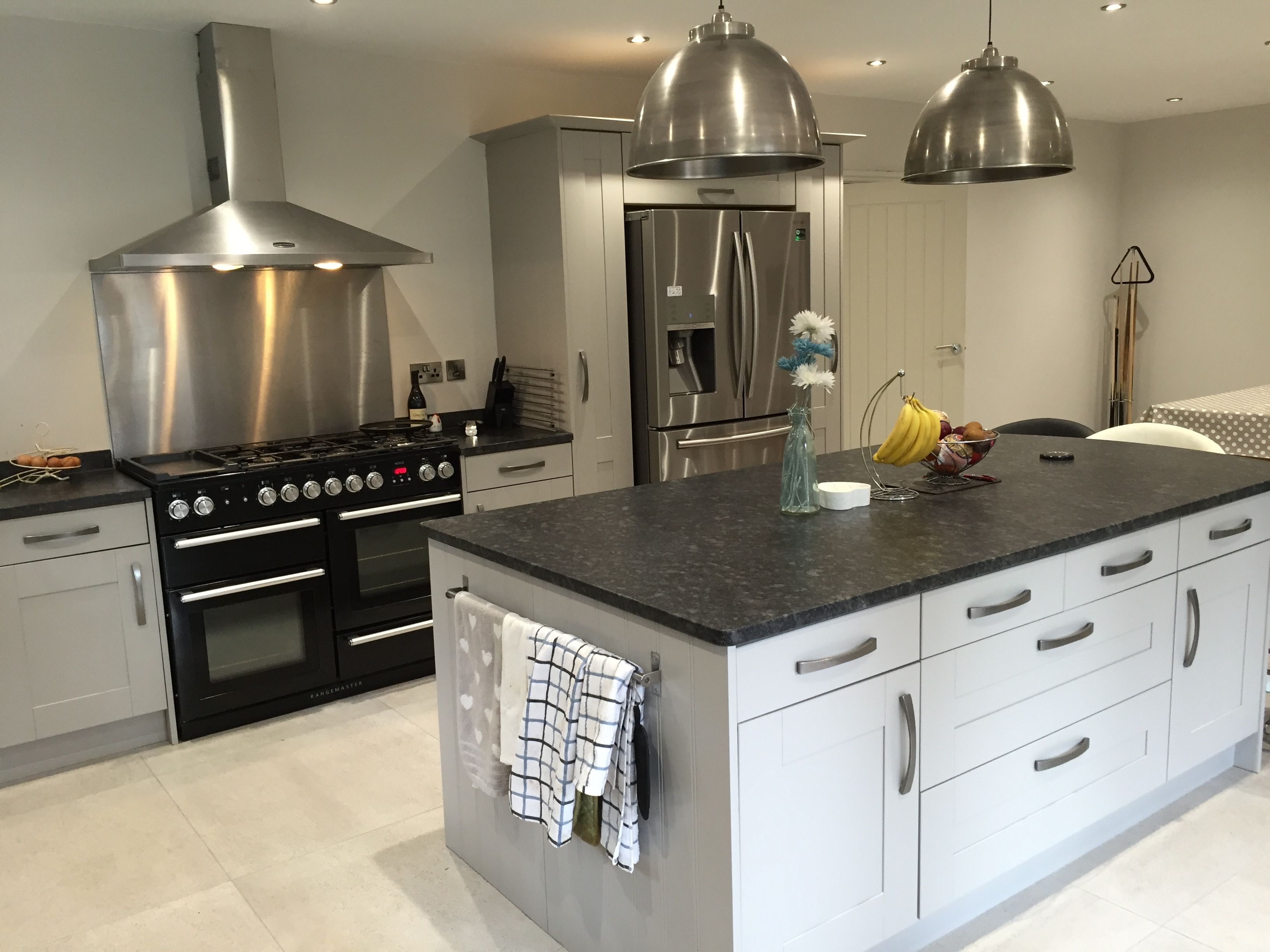 Grey shaker Island with leathered granite stainless steel island
