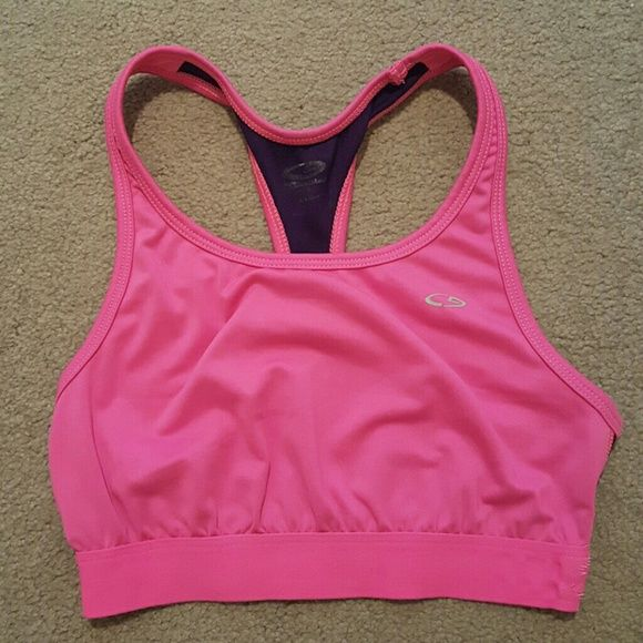 Champion Sports Bra This is a Champion racerback sports bra in pink and navy blue. It is for low to moderate impact activities. Champion Intimates & Sleepwear Bras