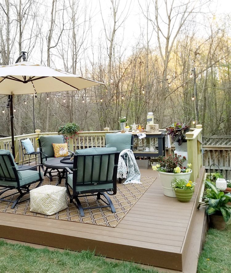 How To Build A Diy Floating Deck In A Sloped Backyard Sloped Backyard Outdoor Living Deck Building A Floating Deck