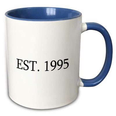 The Party Aisle Why drink out of an ordinary mug when a custom printed mug is so much cooler? This ceramic mug is lead-free, microwave safe and FDA approved. Hand washing is recommended. Color: Blue, Capacity: 11 oz., Theme: Est. 1995