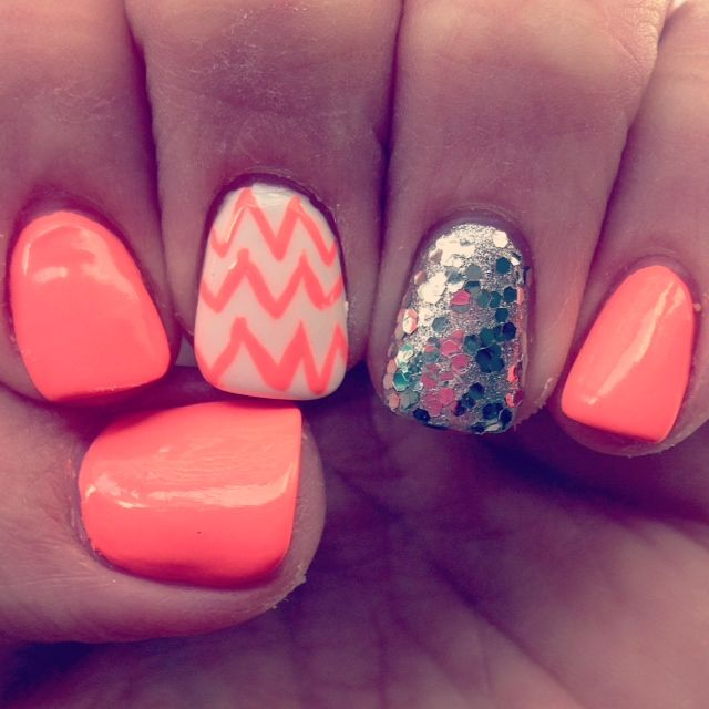 LOVE my neon coral nails!  Chevron with silver bling to top it off. So cute!