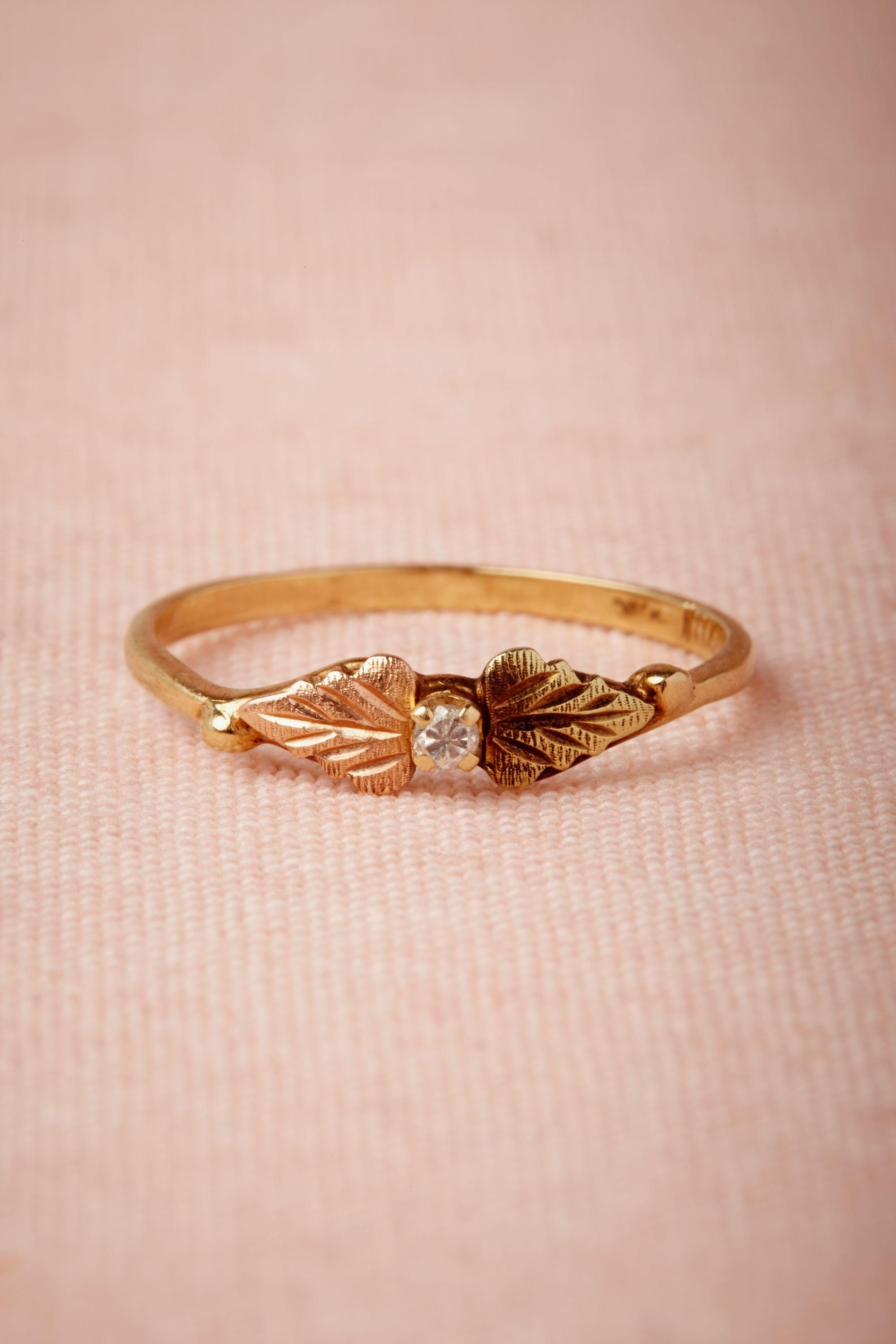 I love this tiny diamond and gold ring. bigger is not always better ...
