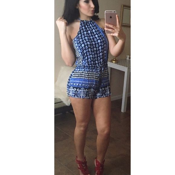 BLUE SUPER CUTE TAZZLE ROMPER NEW SMALL NEW IN BAG ( DOES NOT COME WITH TAGS) ( ONLY TRIED ON TO MODEL)  BLUE HALTER TAZZEL SUPER CUTE ROMPER WAIST IS ADJUSTABLE KEY HOLE BACK   SIZE SMALL   ✨ SMOKE & PET FREE HOME    READ CLOSET INFO B4 PURCHASING   NO TRADES ☺️ NO NEGATIVE RUDE OR UNNECESSARY COMMENTS ❌ Pants Jumpsuits & Rompers