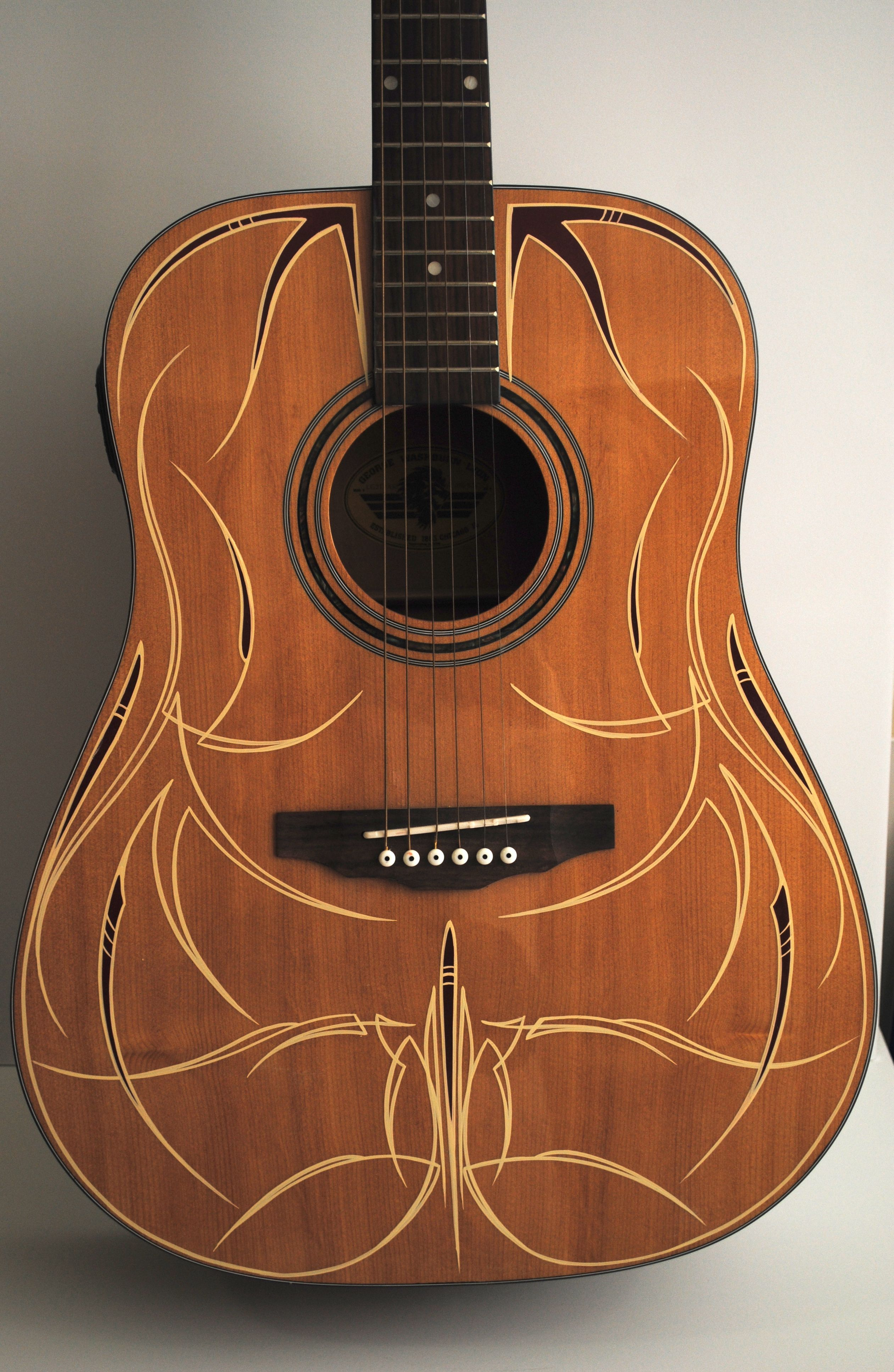 Rob valentini valentini pinstriping finished up the guitar for Acoustic guitar decoration ideas