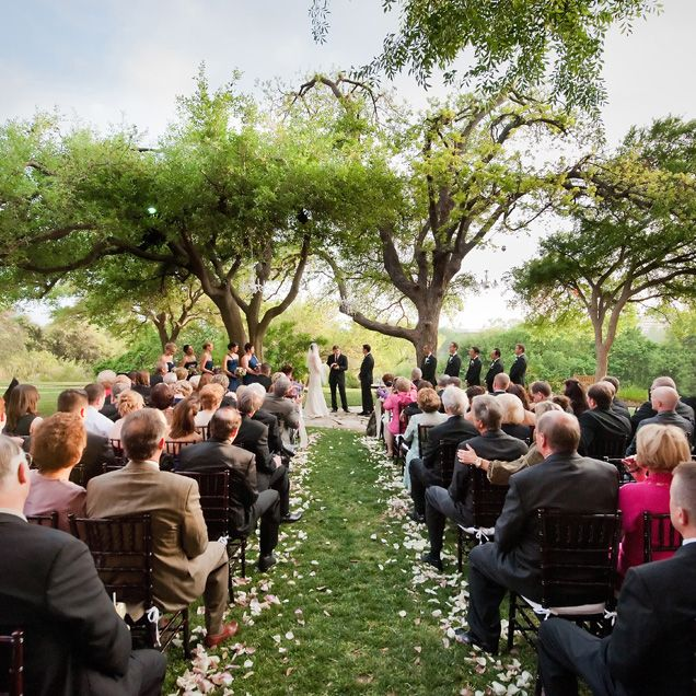 A View Of The Ceremony Under Magnificent Oak Trees