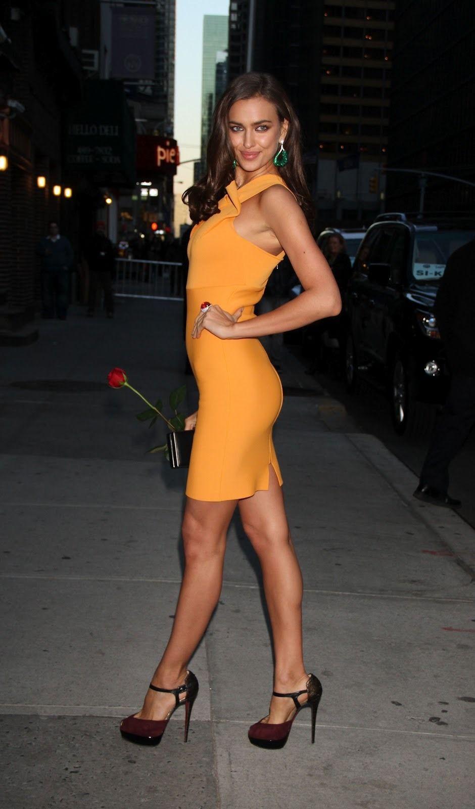 Irina Shayk Sexy Legs In A Curve Hugging Mustard Colored