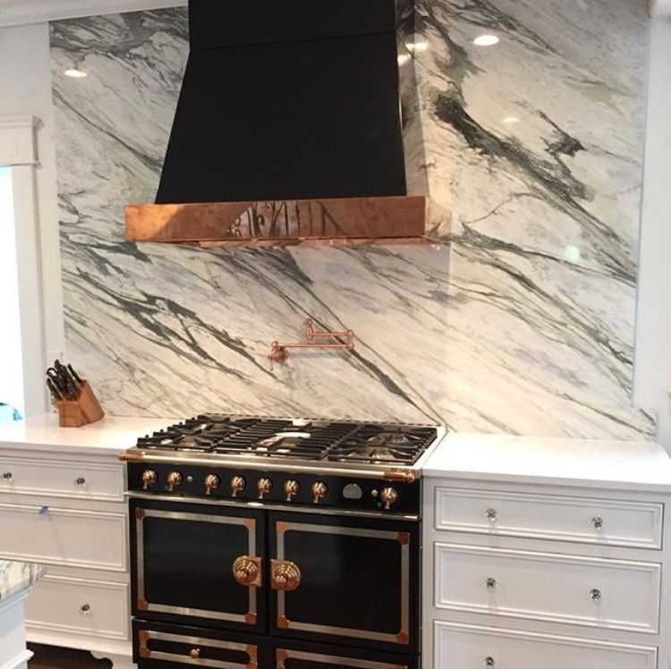 Stunning kitchen with black range hood and calcutta marble slab backsplash transitional - Stunning backsplash designs for behind ranges ...