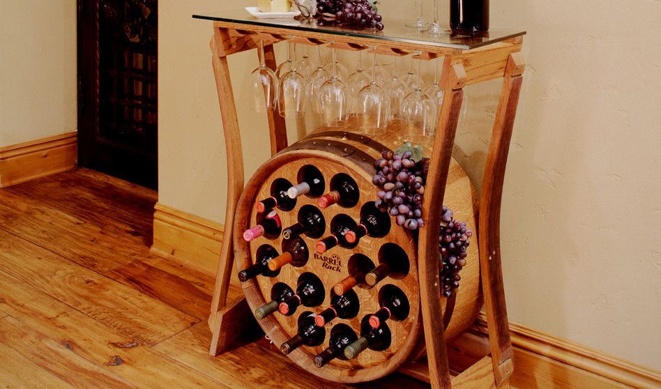 The Barrel Rack wine racks are made from recycled oak barrels modified to cradle your wine bottles, our racks can store up to 3 cases of your favorite wines.