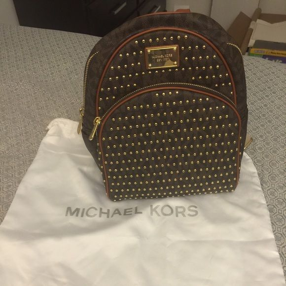Michael kors small studded backpack UP FOR TRADE ONLY! 100% authentic, smoke free, excellent condition, only flaw is shown on the 4th pic, dustbag not included. (Trade value higher) Michael Kors Bags Backpacks