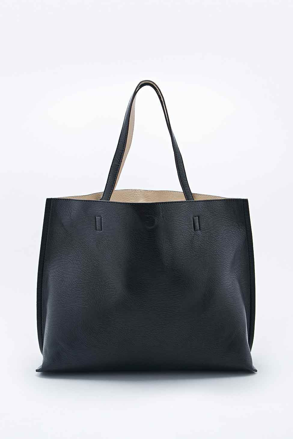 0d6d88a6eccf Reversible Vegan Leather Oversized Tote Bag in Black and Ivory - Urban  Outfitters