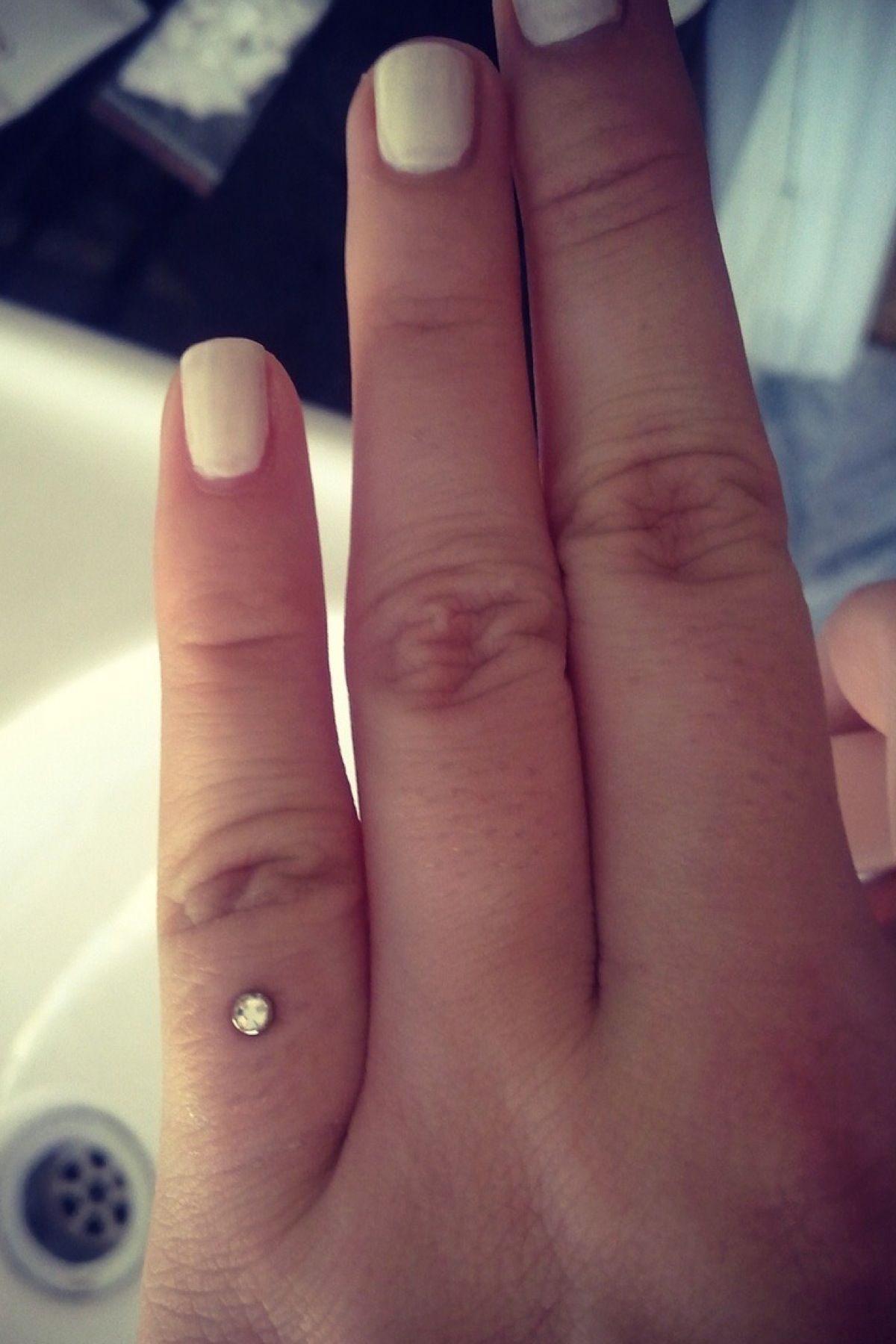 Microdermal piercing ideas  Pinky finger dermal piercing This is actually really cute I would