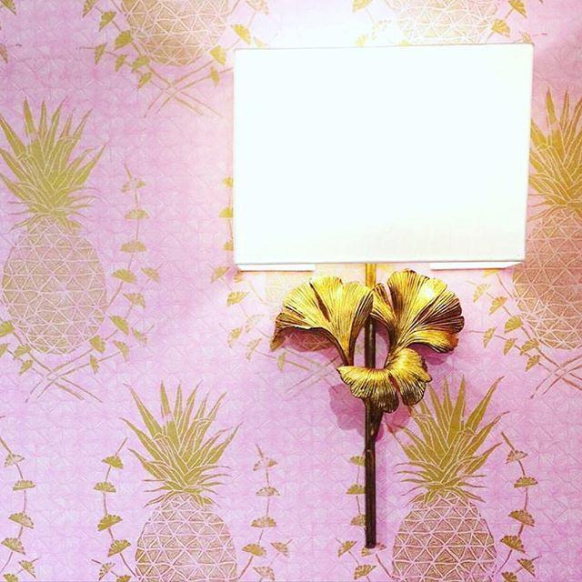 Pink and gold #pineapple-print @kranewallpaper #wallpaper + @curreyco's golden gingko sconce. // Image via @clothandkind. #InteriorDesign: @ivyandvine.