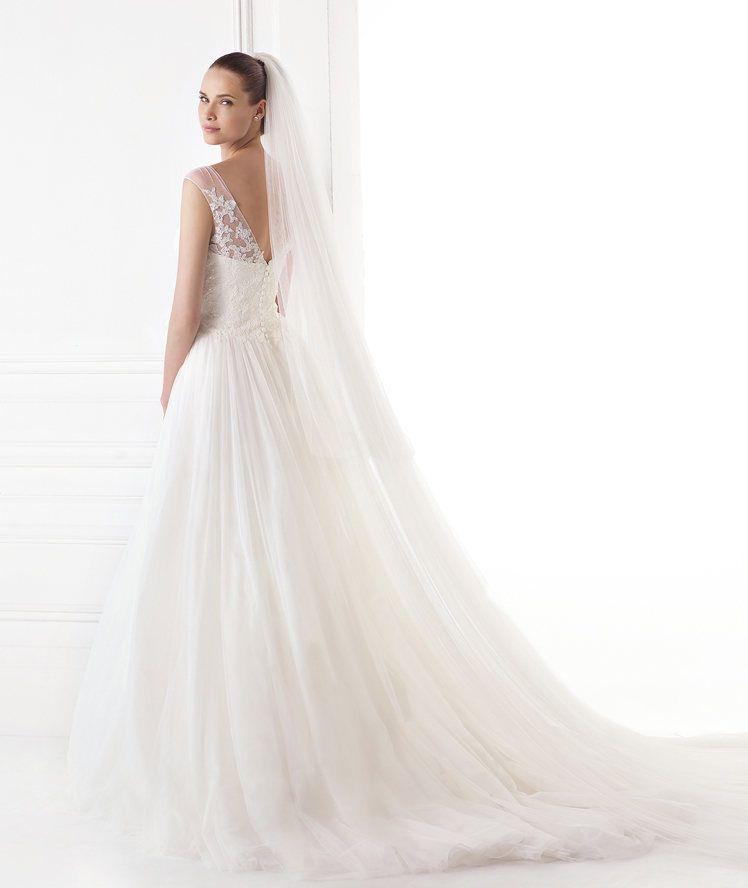 escotes en la espalda que decoran los vestidos de novia | vestidos