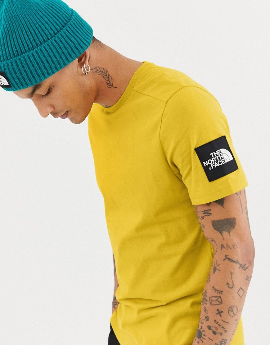 18826d636d6b THE NORTH FACE FINE 2 T-SHIRT IN YELLOW - YELLOW.  thenorthface  cloth