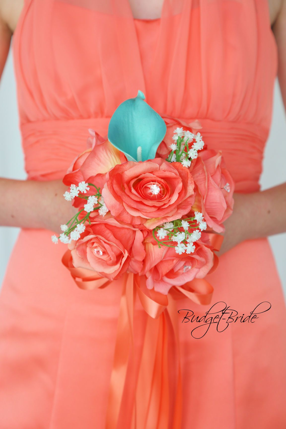 Coral reef and teal wedding flowers with bling and babies