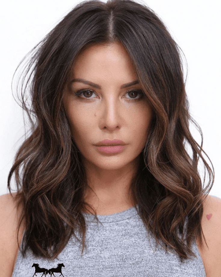 For dark brunettes who don't want obvious golden highlights, take heed from this subtle caramel color, which especially flatters medium to olive skin tones. #brownhair