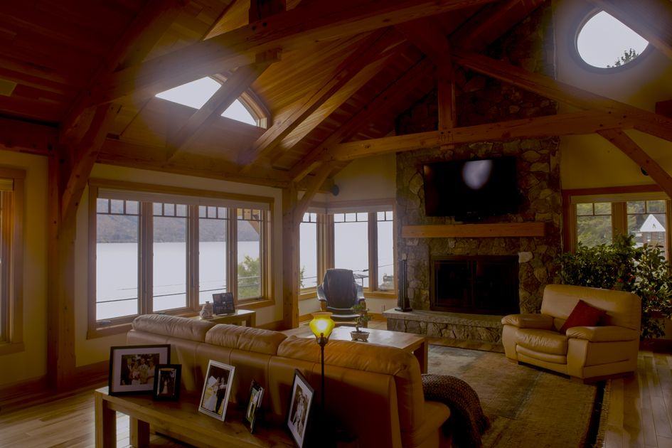 Overlooking Canandaigua Lake this timber frame hybrid homes