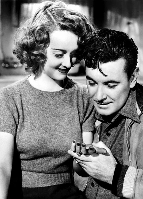 Bette Davis and George Brent. This couple was the Meg Ryan and Tom Hanks of their day. They were in several movies together;