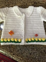 This cute and comfortable baby cardigan is designed to fit babies from birth up to 18 month.