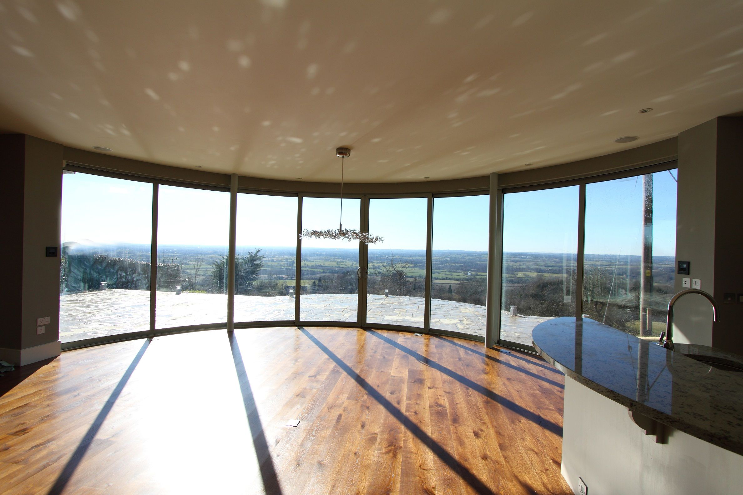 What a view panoramic curved sliding glass doors for Basement sliding doors