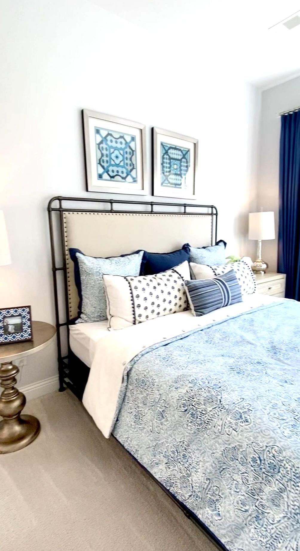 Master bedroom design with light and navy blue accents