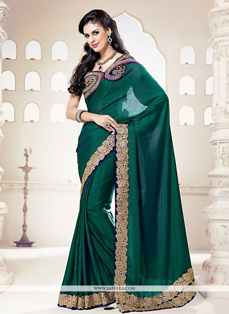 Trendy teal blue saree is fabricated on pure silk create a truly individual look. simple yet elegant design will make you an icon of beauty. saree comes with a matching blouse....