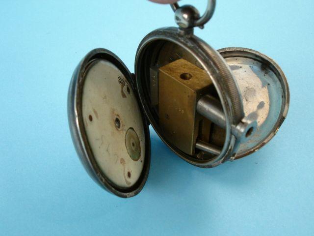 A pocket watch gun made in Britain (.3 cal).