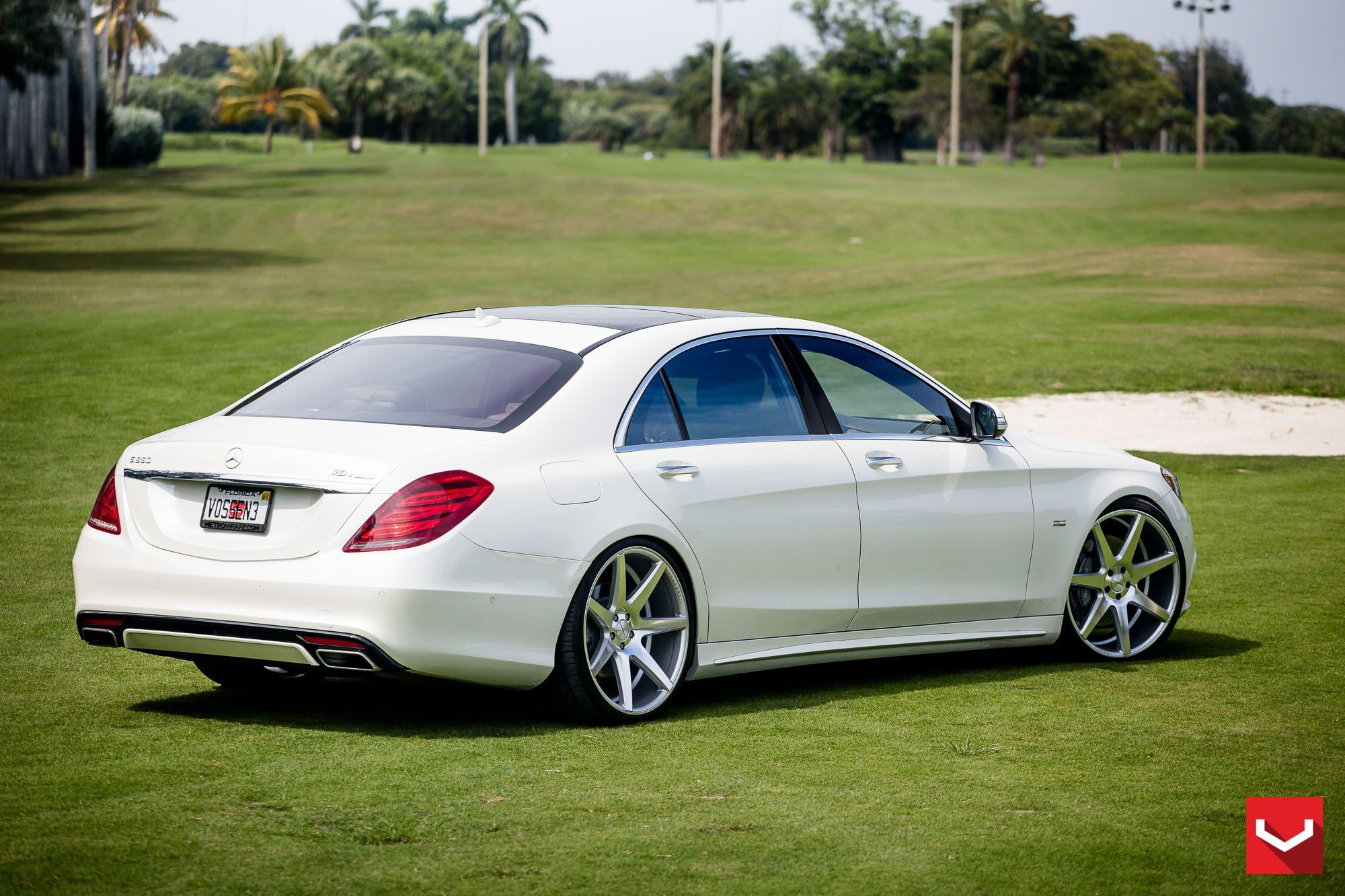 High end white mercedes s class with aftermarket parts