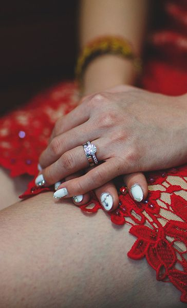 A Beautiful Diamond Engagement Ring On The Bride S Fingers With