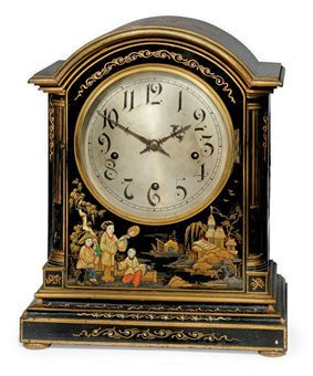 A GERMAN BLACK AND POLYCHROME CHINOISERIE QUARTER-CHIMING TABLE CLOCK