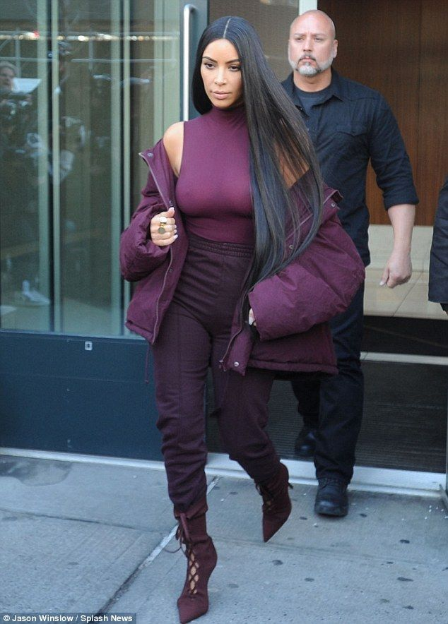 4d01cc8bc54d9 Colorful look  Kim Kardashian left her apartment on Wednesday as she headed  to the Yeezy 5 show in new York. Monochrome Outfit in burgundy.