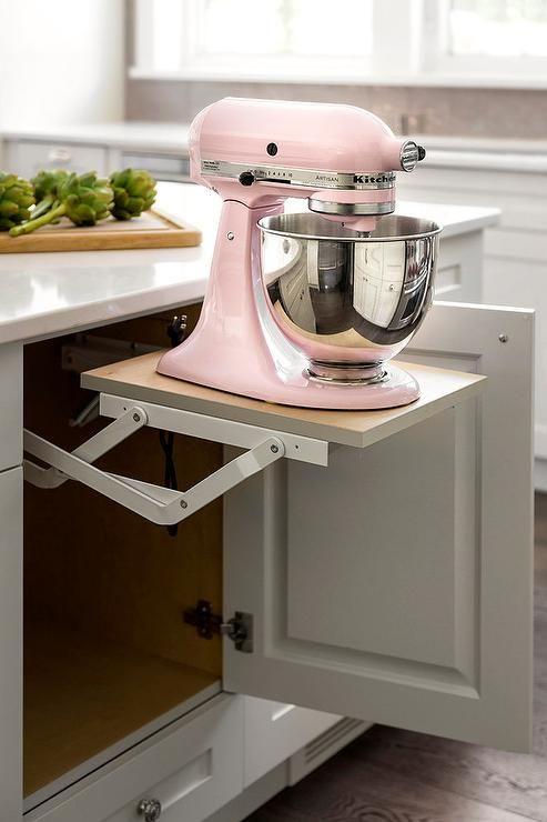 A Pink Kitchenaid Mixer Sits Atop A Pop Up Shelf Fixed Beneath A