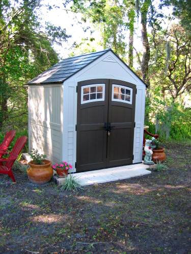 this suncast sutton resin storage shed protects your tools sporting equipment and outdoor furniture through all kinds of weather