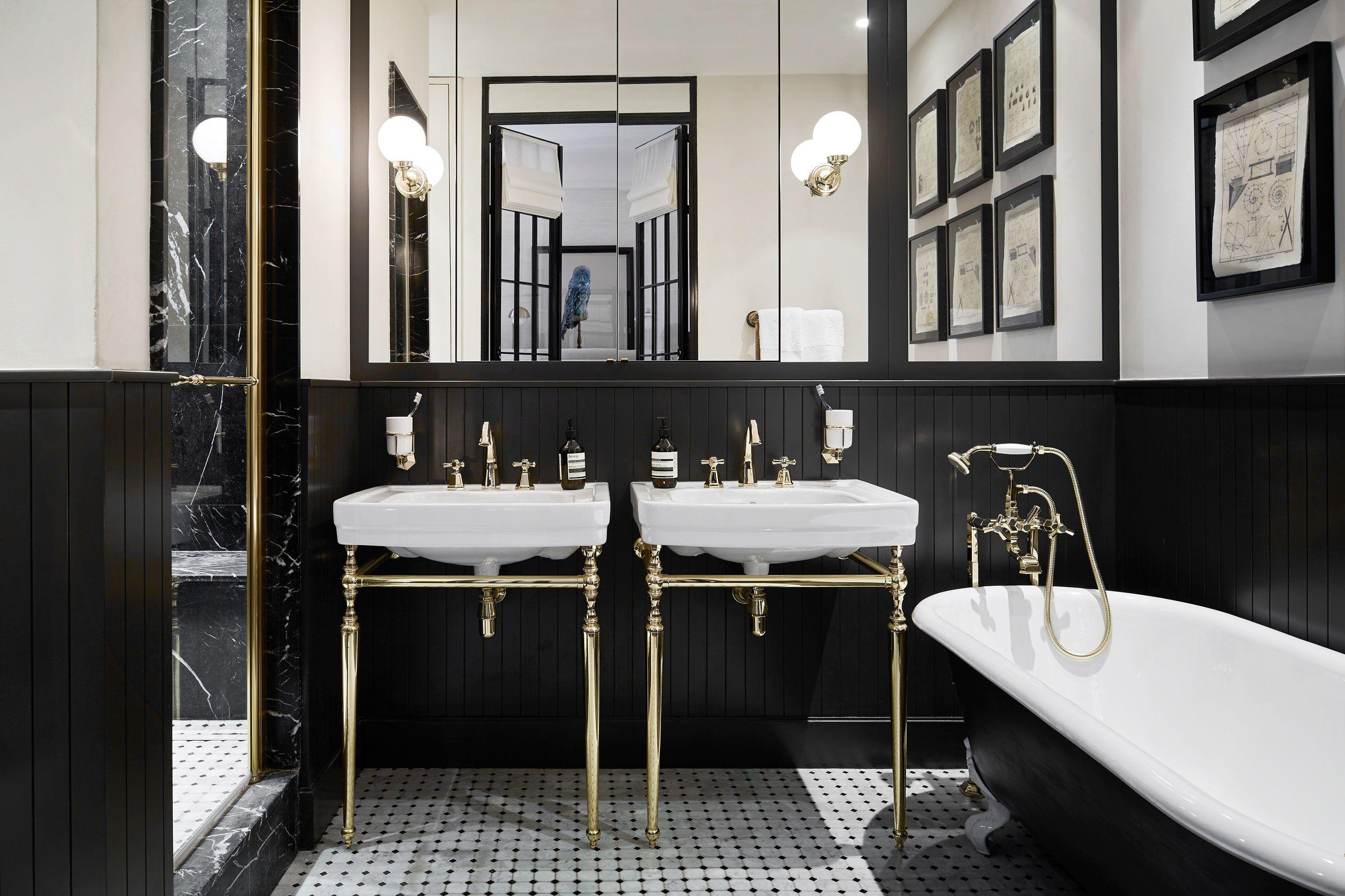 A Classic Parisian Apartment That Blends Old And New Bathroom Interior Parisian Bathroom Best Bathroom Paint Colors