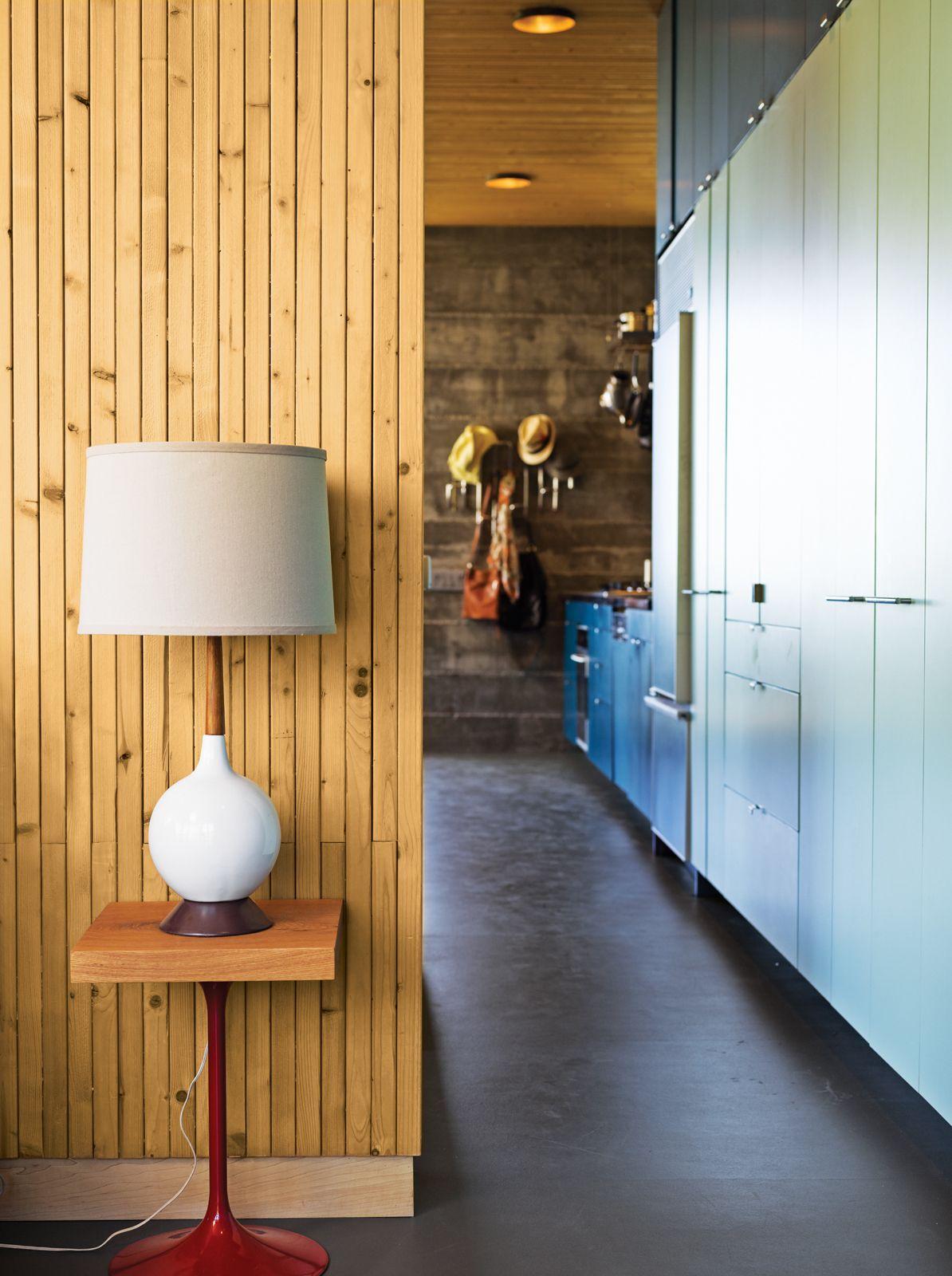 Modern kitchen hallway with wood paneled wall
