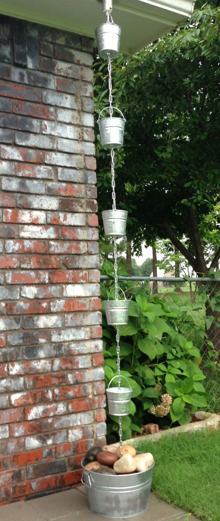 D.I.Y. rain chain ideas   Small galvanized pales from the dollar store and some chain, can make at home.