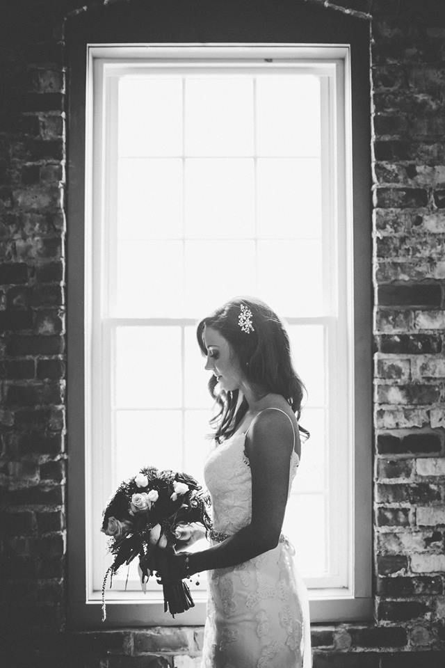 Gorgeous bridal portrait with the Ballroom Suite windows! Photo by Sweet Lemon Drop Photography.#historicbuilding #goshenindiana #michianawedding #weddinginspiration #weddingvenue #breadandchocolate #weddingdecor #wedding #brideroom #brideandgroom #rusticwedding #vintagewedding #bride #bridalportrait #bridalphotographyposes