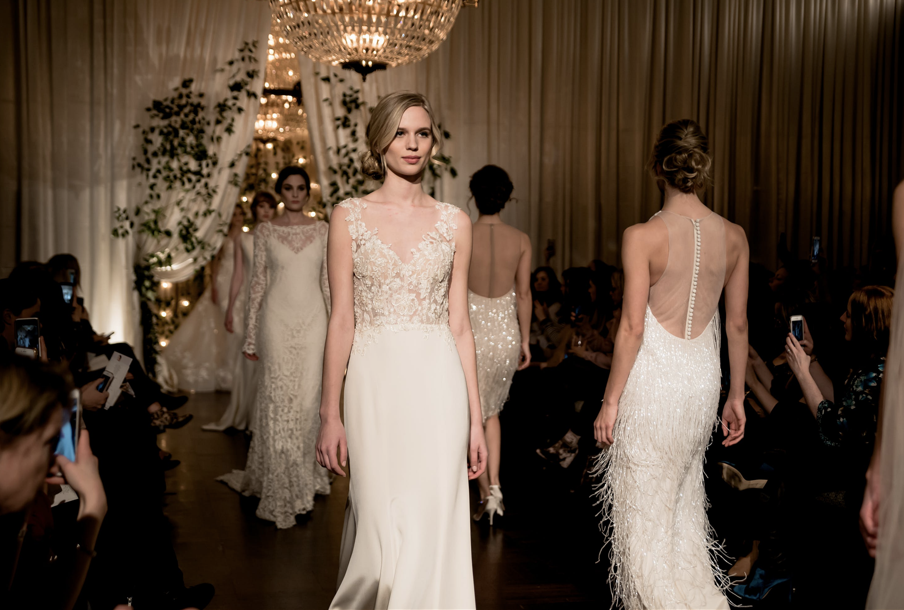 a422f226 Jenny Yoo Collection, the Keaton bridal gown features an illusion V neck  and back with beaded applique, adding sparkly dimension. Covered buttons  down the ...