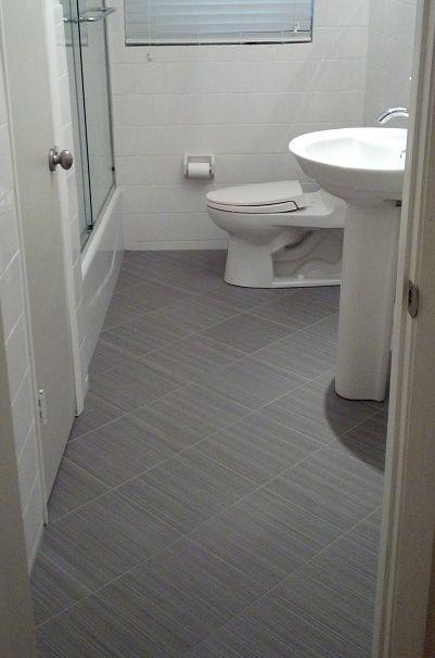 Ceramictec 12x12 Daltile Fabrique Unpolished Gris Linen Porcelain Tile Bathroom Floor With A 6x6 White Wainscot In Tile Bathroom Daltile Grey Bathroom Floor