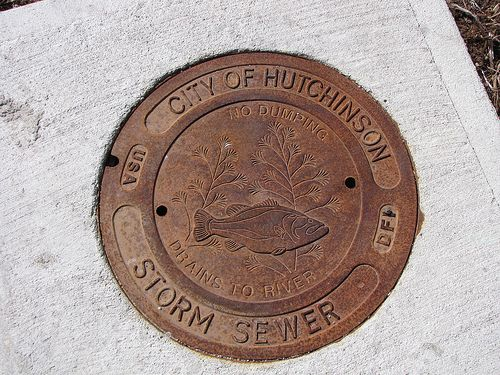 """Manhole Cover Manhole cover in Hutchinson Kansas. Sewer drains to river thus """"No Dumping Drains To River."""""""