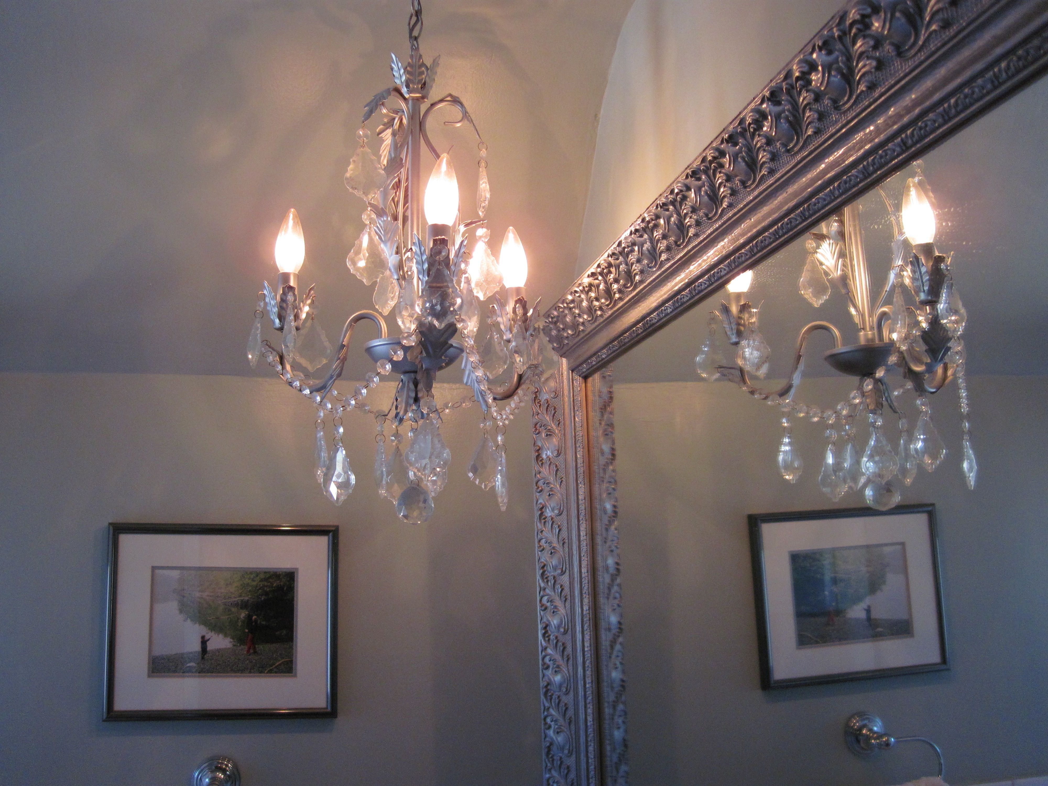 the bathroom is a perfect place for a small chandelier; I ...