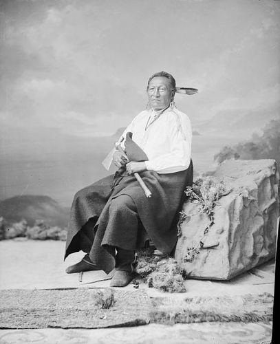 Portrait (Front) of Shu-De-Ga-Xe or Shu-Da-Ga-Ka (Smoke Maker) - Ponca, Chief of Native Police, in Partial Native Dress with Ornaments and Holding Pipe-tomahawk 14 NOV 1877 by William Henry Jackson (1843-1942)