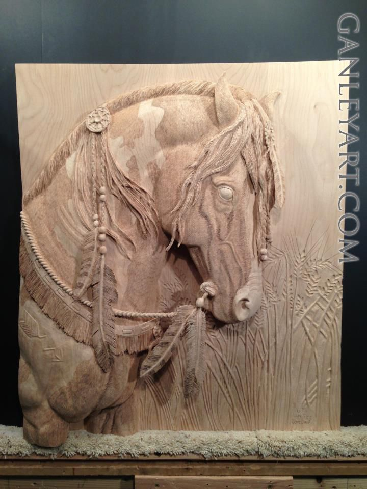 Dave Ganley woodworking... indian horse head with feather and war paint: very detailed and intricate wood carving done all by hand.