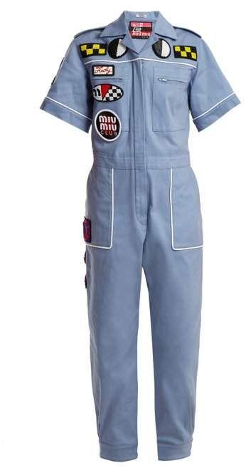 37f3ab3ce1d Miu Miu - Badge Appliqué Cotton Blend Jumpsuit - Womens - Light Blue ...