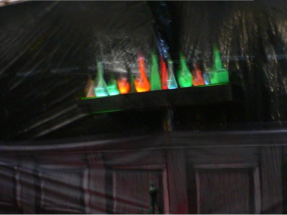 halloween lighting ideas. Easy Black Light Shelf With Glow-in-the-dark Bottles And Potions Halloween Lighting Ideas