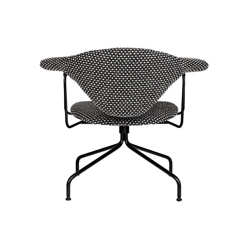 GUBI Masculo lounge chair with swivel base and Dedar Pon