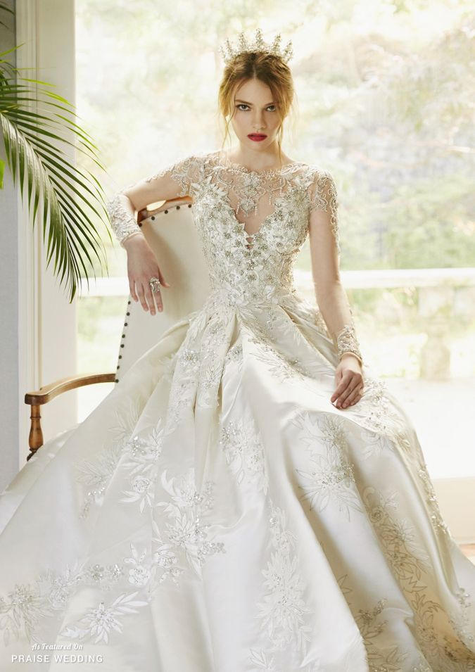 This stylish wedding gown from Abel by K featuring exquisite jewel ...