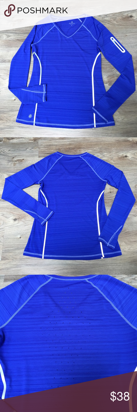 """Athleta Zinger top, Long Sleeve, Small Practically brand new I don't think I ever wore it because I have way too many athletic clothes. Amazing blue/purple. It looks more purple than it does in the pictures. I think the actual color is """"power blue"""" but to me it looks blue/purple. Awesome key pocket on the sleeve and breathable back! Athleta Tops Tees - Long Sleeve"""